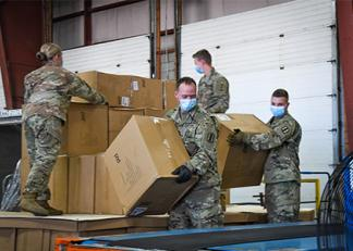 National Guard unloading boxes of PPE